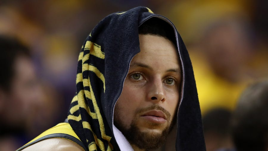 Stephen Curry sits on the bench during Game 2 against