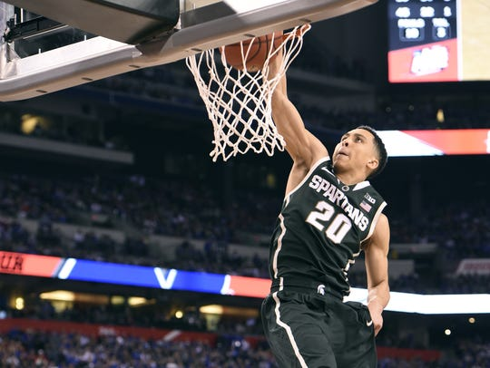 MSU's Travis Trice throws down a dunk late against