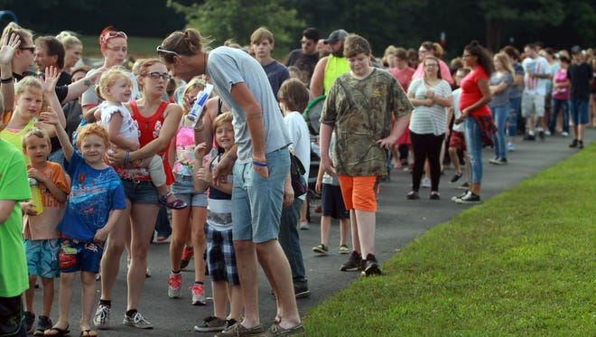 Families line up to receive backpacks at a previous Back to School Bash sponsored by the Portland Chamber of Commerce.