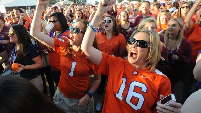 Clemson fans take part in a ACC FanFest outside Camping World Stadium in Orlando on Saturday, December 3, 2016.