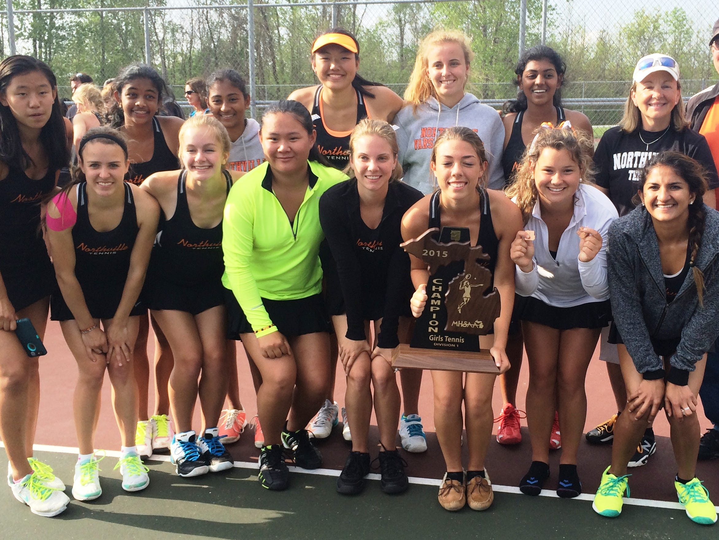 The Northville girls tennis team brought home the first-place trophy by winning Friday's MHSAA Division 1-Region 2 tournament at Novi Middle School.