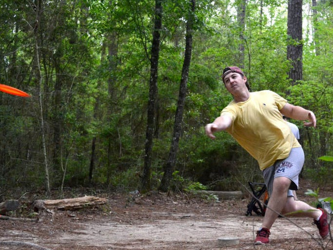 Drew Hamm tees off on hole four of Tatum Trails Disc Golf Course Tuesday.  Hamm is a grad school student at William Carey University and has been playing disc golf for over a year.