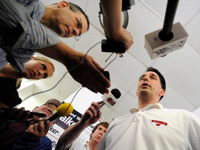 Governor Scott Walker talks to the media at the Manitowoc County Republican Headquarters on Washington Street on Saturday, June 21, 2014 in Manitowoc.