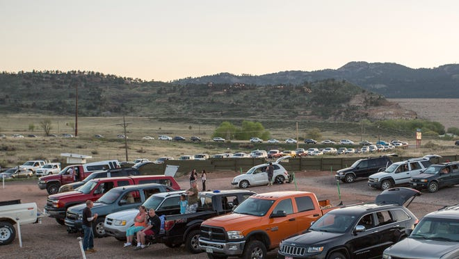 Cars were lined up on Overland Trail, waiting to get into the opening night showings at the Holiday Twin Drive-in on Friday, May 5, 2017.
