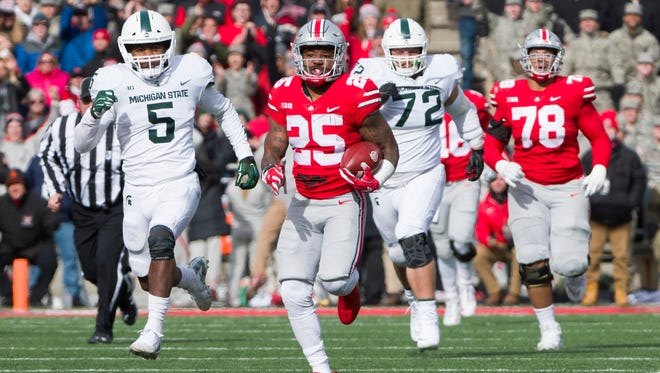 Former Cass Tech standout and Ohio State running back Mike Weber ran for 162 yards, including two TDs of 47 and 82 yards, against Michigan State last week.