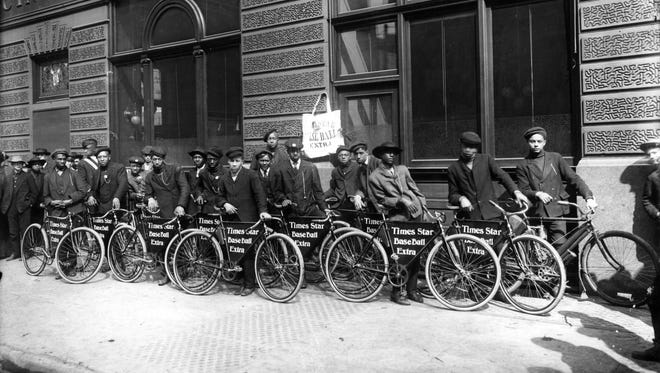 """This photo of Cincinnati Times-Star newsboys lining up circa 1910s is part of the """"Treasures in Black and White"""" exhibit at 1628 Ltd."""