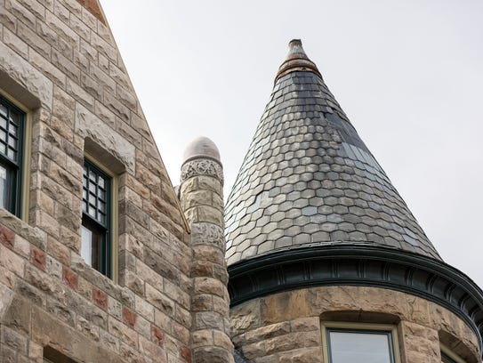 Slate roofing covers the turret of the James Scott