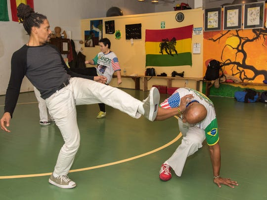 Kasey Sanders, owner of Afro Brazilian Martial Arts and Fitness, Long Branch works with client Thomas Singleton of Long Branch.