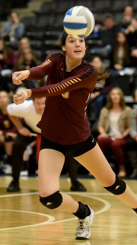 Harrisburg's Samantha Slaughter bumps the ball against