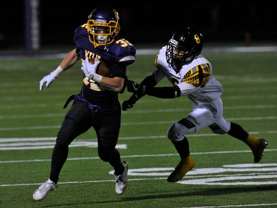 Wylie High School's Cason Grant outruns Snyder High School defensive back Timothy Sosa during a 27-7 Wylie victory in a district game on  Oct. 27. Next year, Wylie is moving up to Class 5A Division II, while Snyder is dropping to Class 4A Division II.