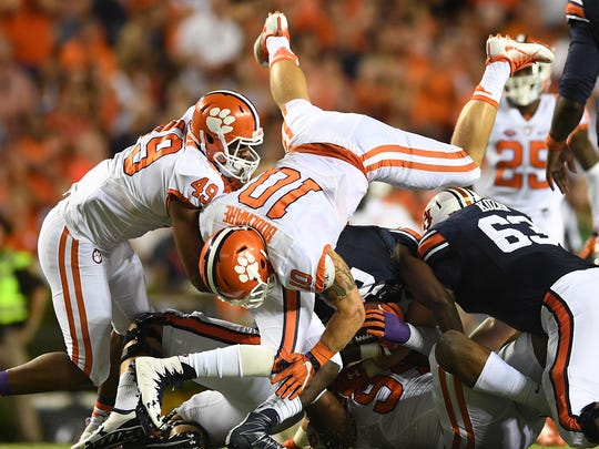 Clemson linebacker Ben Boulware (10) and defensive tackle Carlos Watkins (94) bring down Auburn running back Kerryon Johnson (21) during the 2nd quarter on Saturday, September 3, 2016 at Auburn's Jordan–Hare Stadium.