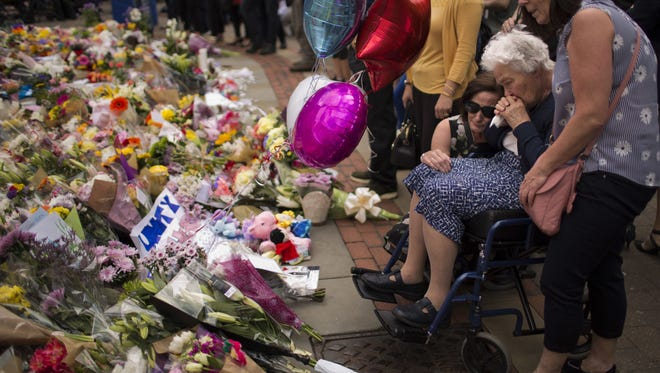 AP Women cry after placing flowers in a square in central Manchester, England, Wednesday, after the suicide attack at an Ariana Grande concert that left at least 22 people dead and many hurt. Women cry after placing flowers in a square in central Manchester, Britain, Wednesday, May 24, 2017, after the suicide attack at an Ariana Grande concert that left more than 20 people dead and many more injured, as it ended on Monday night at the Manchester Arena. (AP Photo/Emilio Morenatti)