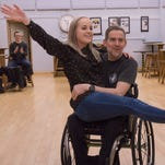 Dad won't let wheelchair stand in way of dance at daughter's wedding