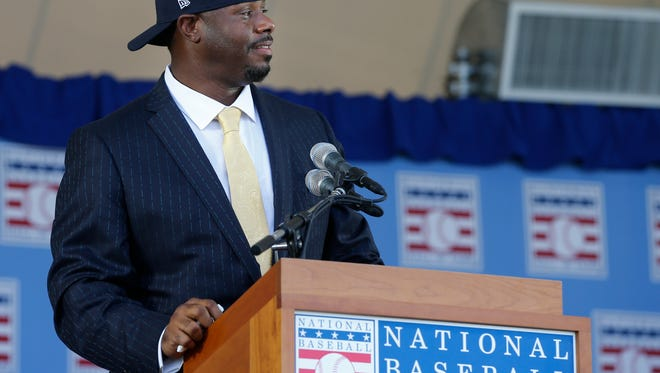 Former Seattle Mariners and Cincinnati Reds player, Ken Griffey Jr., puts on his signature baseball hat backward during the induction ceremony into the National Baseball Hall of Fame, Sunday, July 24, 2016, at the Clarks Sports Center in Cooperstown, N.Y.