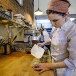 The Little Bird Bakeshop pastry chef and owner, Amy Wyatt, puts the finishing touches on a vanilla creme brulee. The bakeshop will host a Mother's Day tea and treats event Sunday.