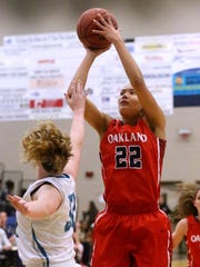 Oakland's Maddie Cook (22) goes up for a shot as Siegel's