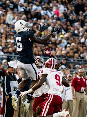 Penn State's DawSean Hamilton goes up and hauls in a pass Indiana University's Jonathan Crawford(9) and Tony Fields and to secure his place as Penn State's all time career receptions leader as Penn State beat Indiana University 45-14 on Saturday, Sept. 30, 2017.
