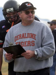 -  -GFT, 26.11.2003:3S --Geraldine Tigers head coach Rod Tweets walks along the coaches box during their game versus the Custer-Melstone Cougars at Tiger Stadium in Geraldine, Montana, Saturday, November 15, 2003. Tribune Photo by Jerome T. Nakagawa