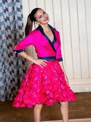Melanie Coppola models a cocktail dress by Sabre Mochachino,
