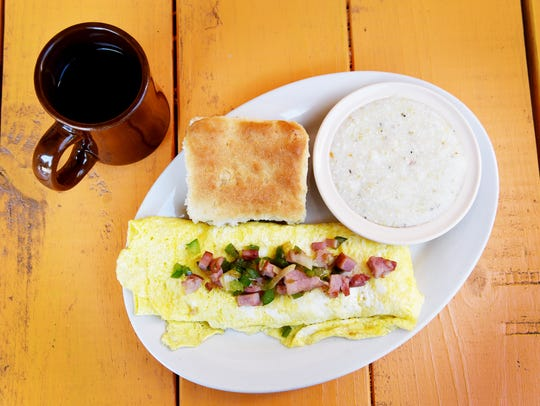 Tastee Diner's Denver omelette with grits and a biscuit