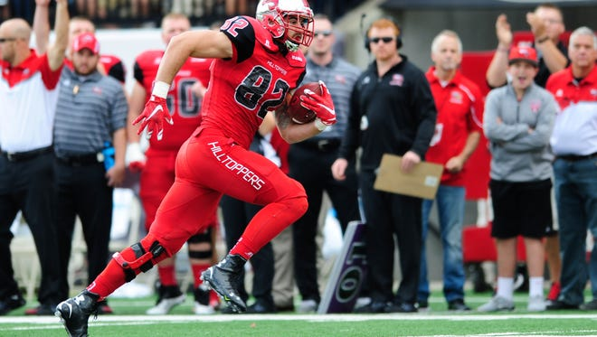 Oct 10, 2015; Bowling Green, KY, USA; Western Kentucky Hilltoppers tight end Tyler Higbee (82) carries the ball during the first half against Middle Tennessee Blue Raiders at Houchens Industries-L.T. Smith Stadium. Mandatory Credit: Joshua Lindsey-USA TODAY Sports
