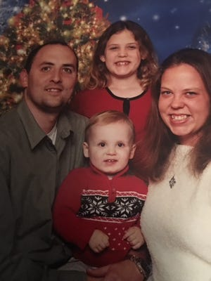 Melanie Crow, who was killed on Sunday at a church shooting in Nashville, pictured with her family husband Royce Smith, son R.J. and daughter Breanna. Photo used with permission.