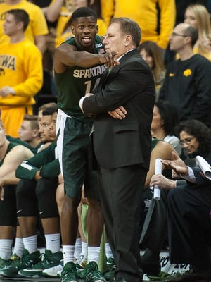 Michigan State's Eron Harris tries to explain himself to coach Tom Izzo during Tuesday's game in Iowa City. Harris finished with a team-high 21 points.