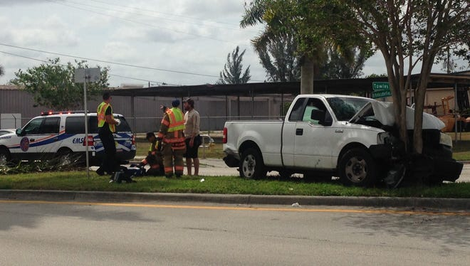 The driver of the pickup was hurt when she swerved to miss another car and hit a tree.