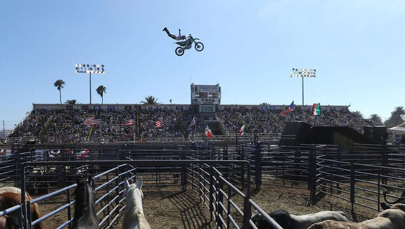 Luke Dolin, freestyle motocross rider, performs an