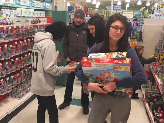 Shoppers go through the aisles at the Christiana Toys