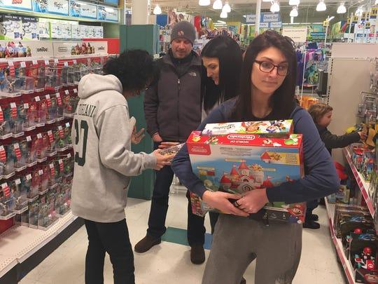 Shoppers go through the aisles at the Christiana Toys
