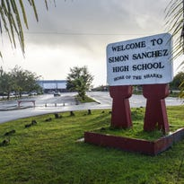 Students exit for the day at Simon Sanchez High School in Yigo on Oct. 1.