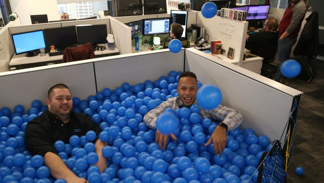 "Joe Hutt and Elvis Montero in the ""ball pit"" at Datto in Rochester."