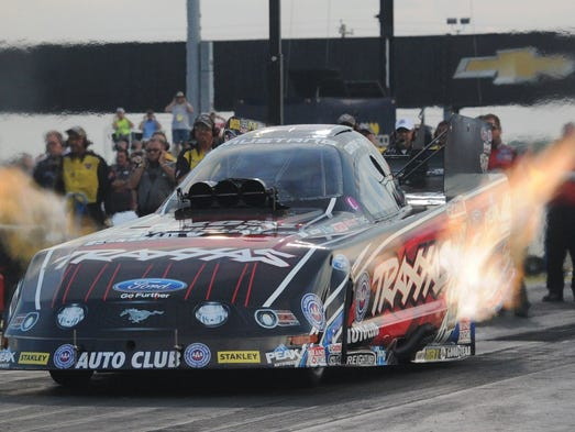 Courtney Force leaves the line during the NHRA US Nationals at Lucas Oil Raceway, Friday August 29, 2014.