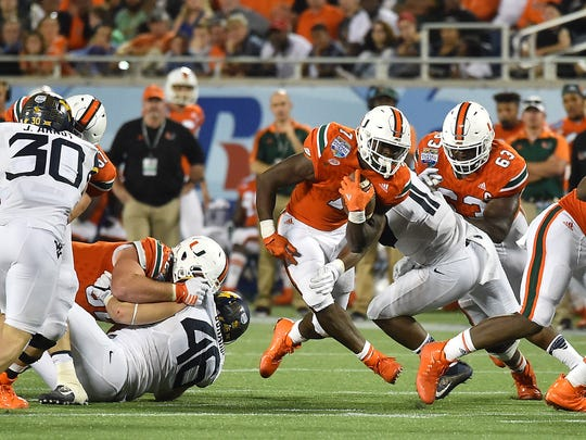 Dec 28, 2016; Orlando, FL, USA; Miami Hurricanes running