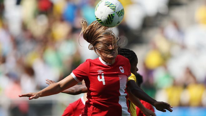 Michigan's Shelina Zadorsky heads the ball clear during Canada's 2-1 bronze medal victory over Brazil.