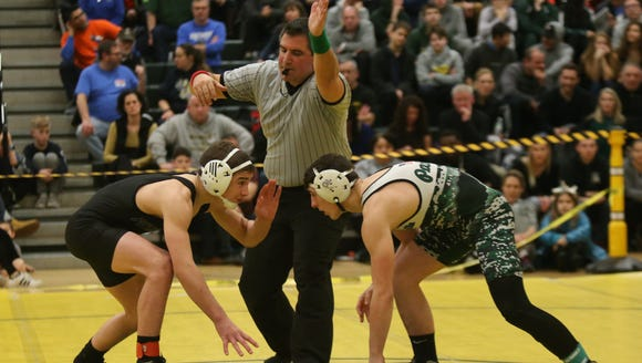 Pleasantville's Victor Perlleshi, right, defeats Putnam