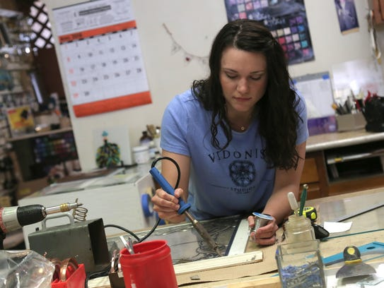 Tiffany Vidonish-Knell solders a joint in the workspace