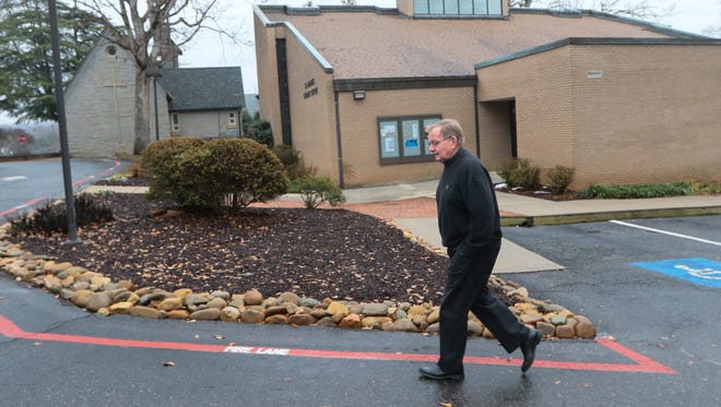 Father Dan McLellan of Saint Andrew Catholic Church in Clemson walks though the area of the proposed planned development of the church in Clemson.