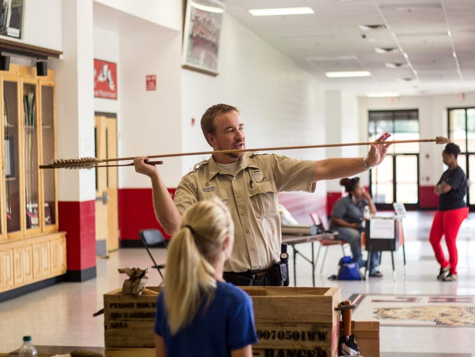 Ranger Wes Williams demonstrated the uses of different artifacts at the Natchez Trace State Park Table during the Family Affair event at Lexington High school
