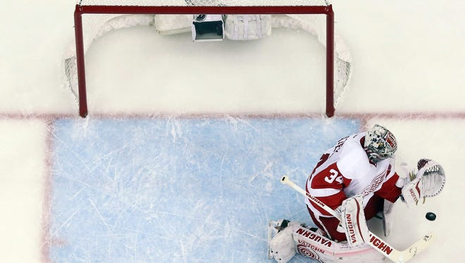 Detroit Red Wings goalie Petr Mrazek makes a save on a shot by the Tampa Bay Lightning during the second period of Game 5 of a first-round NHL Stanley Cup hockey playoff series Saturday, April 25, 2015, in Tampa, Fla. The Red Wings won 4-0.