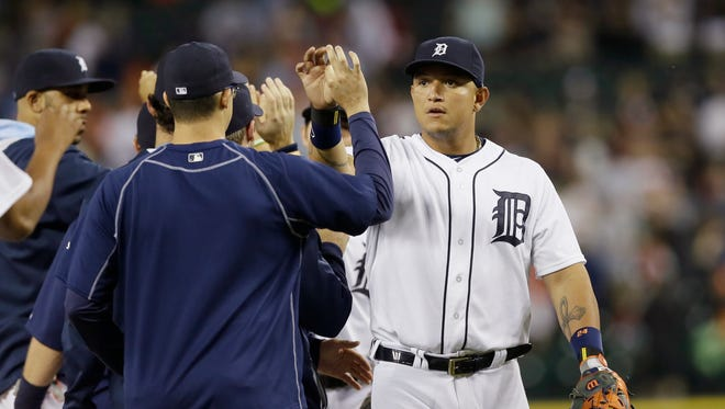 Detroit Tigers first baseman Miguel Cabrera greets teammates after their 6-0 win over the Cincinnati Reds.
