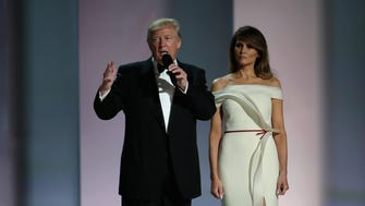 President Donald Trump and first lad Melania Trump prepare to dance at the Liberty Inaugural Ball.