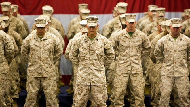U.S. Marines with 1st Battalion, 6th Marine Regiment, stand in formation in 2012 in their camouflage.