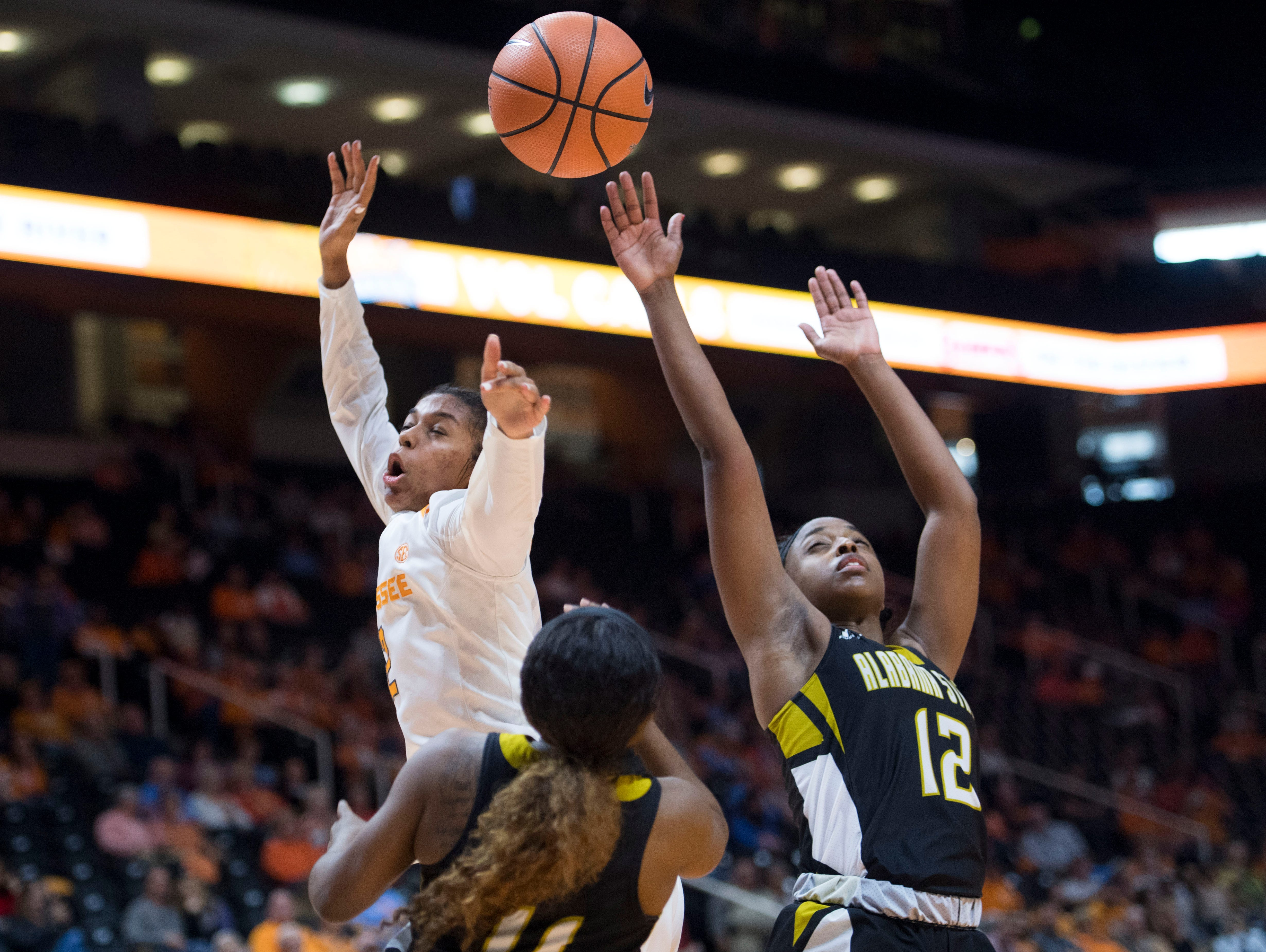 Tennessee's Evina Westbrook turns the ball over to Alabama State's Mya Millner, right, and Shamyiah Smith at Thompson-Boling Arena on Sunday, December 3, 2017.