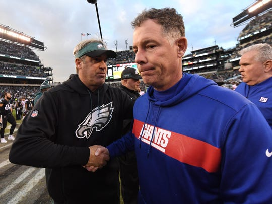 Giants coach Pat Shurmur, right, and Eagles coach Doug Pederson shake hands after Sunday's game.