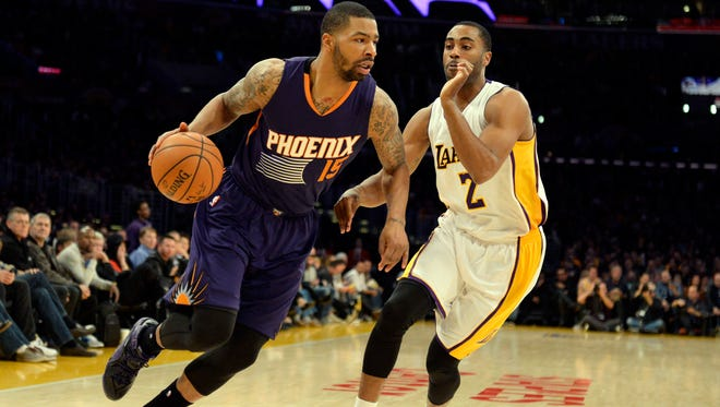 Phoenix Suns forward Marcus Morris (15) drives against Los Angeles Lakers guard Wayne Ellington (2) during the first half at Staples Center on Dec. 28 in Los Angeles.