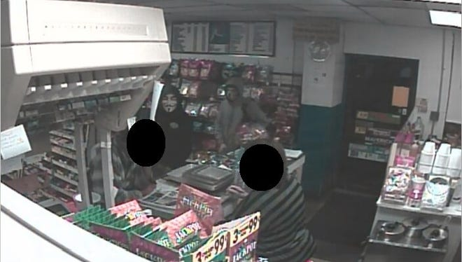 State police are searching for two men who robbed a Seaford-area deli at gunpoint Monday night.