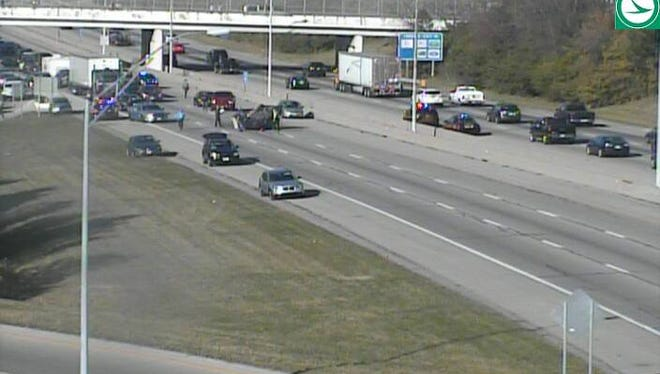 A traffic camera shows a vehicle flipped on southbound interstate 71.