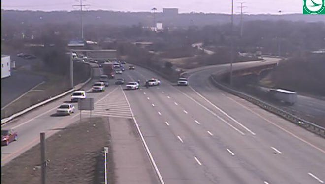 Police cars block all lanes of SB I-71 near the Norwood Lateral.